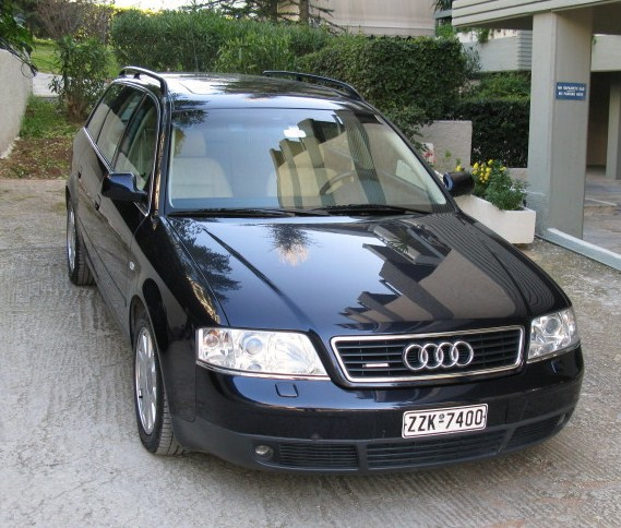 The A6 Avant Turbo Quattro 180 Hp, Y2K, sparkling in the driveway.