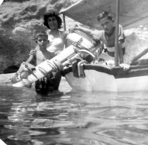 "Early seamanship exposure: here in Katramonisi of Voula, Byron with our Nanny and Nikos aboard ""BYRON"", ca. summer of 1959."