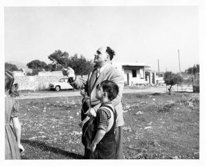 """Byron & father Emmanuel flying the kite on the Day of Lent (""""Katahri Deftera""""), March 1956 in Voula"""