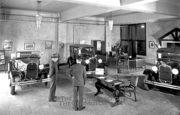 A period Ford Salesroom featuring Ford Model A's.