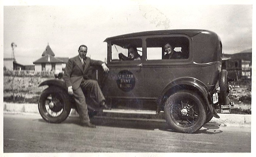 He used a 1930 ford model a tudor as his car and on the for Ford motor company history background
