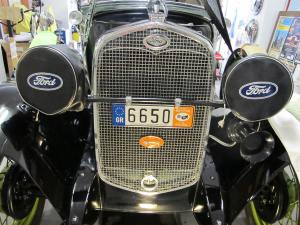 Front radiator view with the stone guard, 'my b-d' bespoke license plate, and the Quail Motometer radiator cap