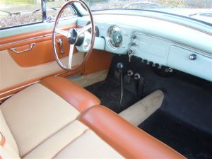 The Aurelia GT's interior featured a split front and one-piece rear bench seat, and the four-speed manual gearbox was shifted on the column; a popular and valuable option was the Nardi floor-shift conversion.