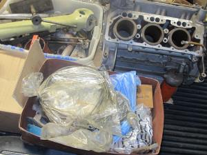 A glimpse of the engine block and a plethora of parts loaded on my Dodge Dakota pick-up